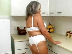sexually excited grandma in kitchen