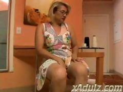 corpulent golden-haired granny doing crochet