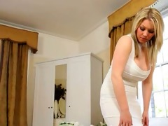 lovely golden-haired bride teasing on ottoman