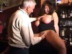large tited milf receives fucked in a bar