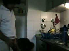 cute wife drilled in the kitchen