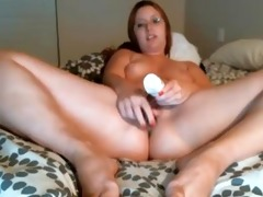bulky wife with glass sex toy on web camera