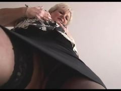 curvy blonde aged in taut skirt and nylons