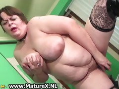 old breasty excited woman is stucking a large