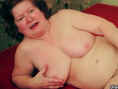 obese granny with shaggy bawdy cleft pulls on her