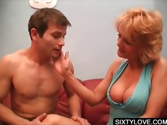 older chick getting cunillingus on bed