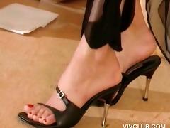 blond sex siren stripping sensually