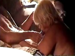 very corpulent golden-haired older blowing