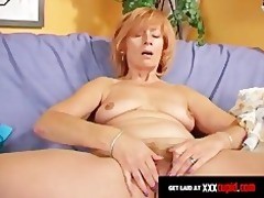redheaded granny uses a sex-toy