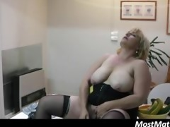 overweight older housewife inserts banana in her