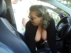 mature woman fucking a lad in his car