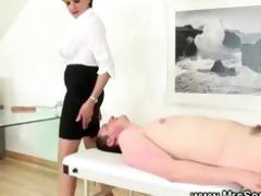 prodomme working her slaves cock in advance of