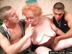older chick engulfing two big knobs