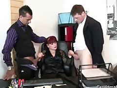 aged office whore enjoys two cocks