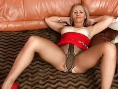 blond milf in hot taut costume and hose shows her