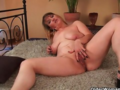 large boobed mom enjoys his fist and penis in her