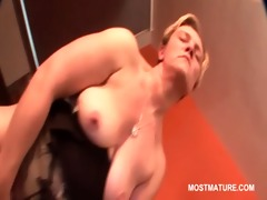 older golden-haired fucking herself with her
