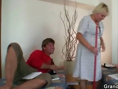 old cleaning woman takes hard weenies