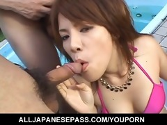 japanese babe sucks off knobs by the pool