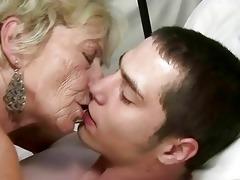 granny and lad enjoying hard sex
