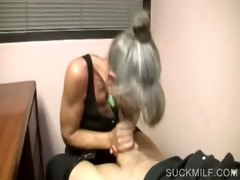 lusty cougar giving hand job on knees